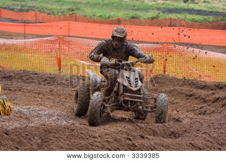 Quad Bike Racing In Dirt And Mud