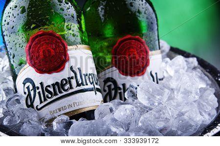 Bottles Of Pilsner Urquell Beer In Bucket With Crushed Ice