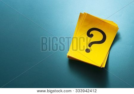 Stack Of Colorful Yellow Cards With Question Mark
