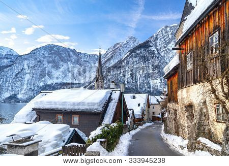 Classic Postcard View Of Famous Hallstatt Lakeside Town In The Alps With Traditional Passenger Ship