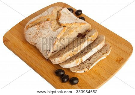 Bread, Ciabatta With Dried Tomatoes And Olives, On A Cutting Board, Isolated On White Background