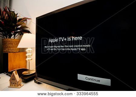 Paris, France - Nov 1, 2019: Side View Of Apple Tv Plus Is Here Message On Living Room Display With