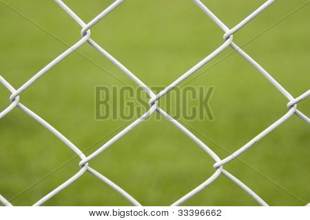 Seamless Wire Fence With Green Field Background poster