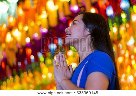 Portrait Of Asian Woman Holding A Traditional Paper Lantern During Yi Peng (or Yee Peng) Festival In