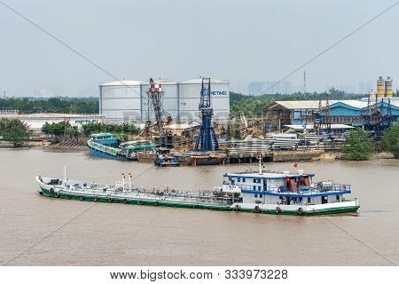 Long Tau River, Vietnam - March 12, 2019: Dong Thap 09 River Taker Sails On Brown Water In Front Of