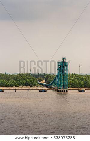 Long Tau River, Vietnam - March 12, 2019: Portrait, Azure Blue Dock And Pipeline Installation Built