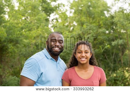 Father And His Daughter Laughing And Playing At The Park.
