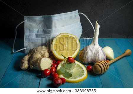 Natural Remedies For Cold And Flu Season With Fresh Root Ginger, Lemon, Garlic And Rose Hips