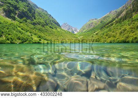 Beautiful summer landscape of Caucasus mountain. Baduk lakes near Dombay in Russia. Daylight mountain landscape.