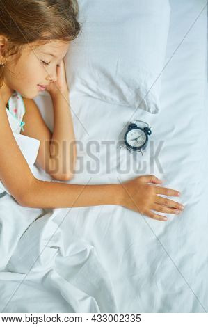 Little Girl Sleeping On A Big And Cozy Bed White Linen In The Afternoon At Home
