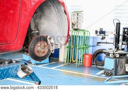 Tyre Replacement Service, Car Disc Brake Without Wheels Closeup At Auto Repair Garage Shop