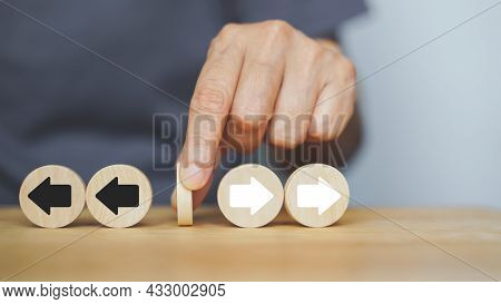 Human's Hand Hold Wood Block Between Opposite Direction Arrow, Black And White For Stop Argument, Pr