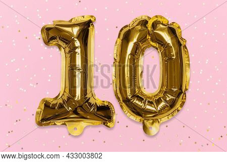 The Number Of The Balloon Made Of Golden Foil, The Number Ten On A Pink Background With Sequins. Bir