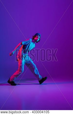 Stylish Sportive Boy Dancing Hip-hop In Stylish Clothes On Colorful Background At Dance Hall In Neon
