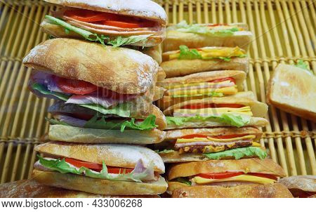 Sandwiches With Fresh Ciabatta And Green Salad On A Shop Window.