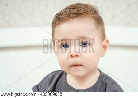 Close-up Portrait Of A Little Caucasian Baby Boy. Healthy Serious Funny Toddler Lovely Kid Concept.