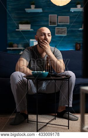 Focused Concentrated Man Watching Interesting Movie Show On Television. Male Sitting On Comfortable