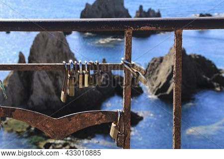 Romantic Padlocks Hanging On The Reef Of The Sirens Railing In Cabo De Gata-nijar, Almeria, Spain