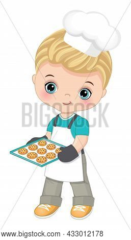 Cute Little Boy Wearing Chefs Toque, Oven And Apron Holding Baking Tray With Cookies. Cute Boy Is Bl