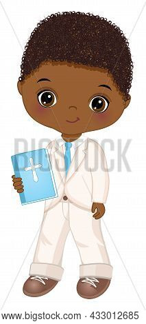 First Communion For African American Boy. Cute Boy Is Curly, Holding Holy Bible. Little Boy Wearing