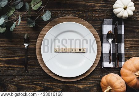 Thanksgiving Place Setting With Plate, Napkin, On A  Decorated Table Shot From Flat Lay Or Top View