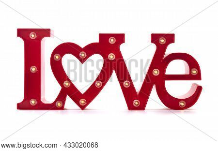 Illuminated Red Love Sign On A White Background