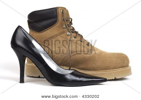 A side shot of one black women's high-heel dress shoe sitting beside a brown workboot against white background poster
