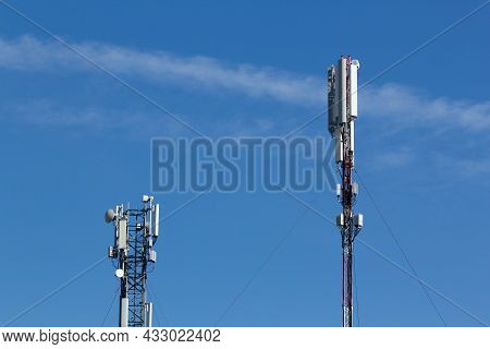 Mobile Cell Phone Tower Against The Background Of A Blue Sky And White Cloud. Telecommunication Tv T