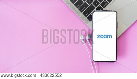 Bangkok, Thailand - September 6, 2021: Smartphone With Earphones Connected To Zoom Video Conference