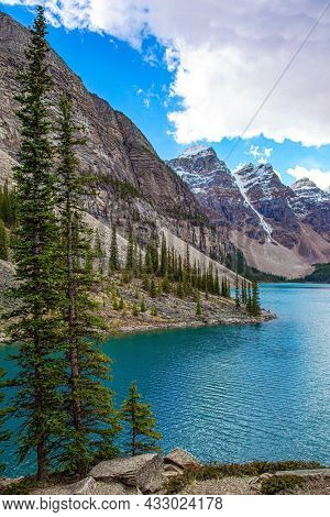One of the most beautiful lakes in the world - Moraine Lake. The glacial lake is fed by glacier melt water and is located in the Valley of the Ten Peaks. Travel to northern Canada. Canadian Rockies