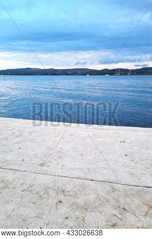 Picturesque Summer View Of Seascape With Mountain Views At Sunset. Traveling Concept