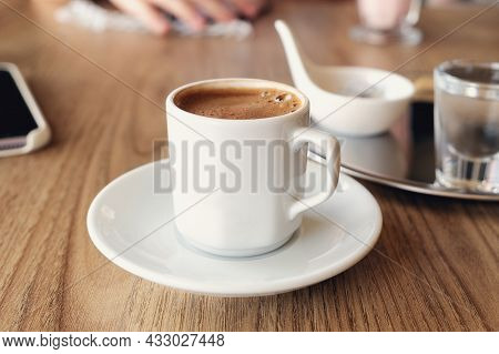 Close-up Of Traditional Turkish Coffee With Cold Water And Turkish Delight. Selective Focus - Image