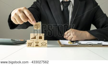 Hand-holding Wooden Cube With Virtual Goals And Goals, Business Success Goals, Goals, Financial And