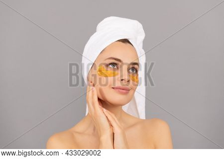 Make Your Skin Shine. Cosmetology. Young Woman In Terry Towel Use Patch. Beauty In Spa.