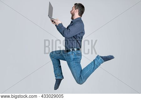 Agile Business. Network Administrator Hold Computer. Energetic Boss With Wireless Laptop.