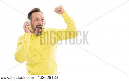 Mature Happy Man In Headphones. Smiling Senior Guy Listen To Music Isolated On White.
