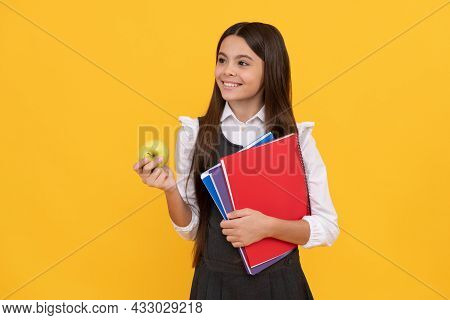 Welcome Back To School. Happy Kid Smile Holding Apple And Books. Back To School. Back-to-school