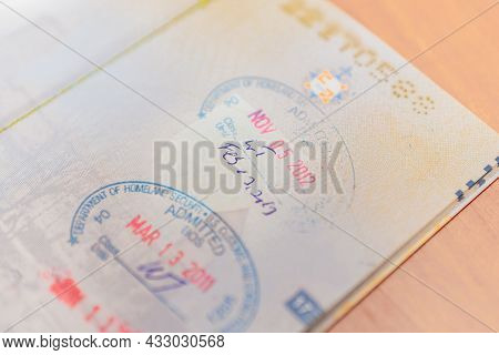 United States Of America Immigration Customs Stamps On The Passport With The Word Admitted.travel Co