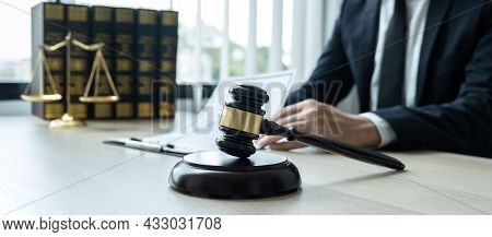 Counselor Lawyer Or Notary Working On A Documents And Report Of The Important Case And Wooden Gavel,
