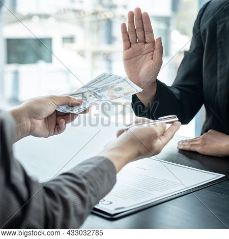 Close Up Of Man Employee Offering Bribe Money And Pen To Businessman To Signing The Contract To Join