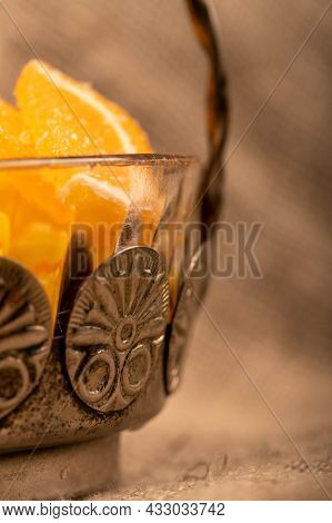Multi-colored Shaped Marmalade Lemon Slices In A Vintage Vase, Close-up, Selective Focus