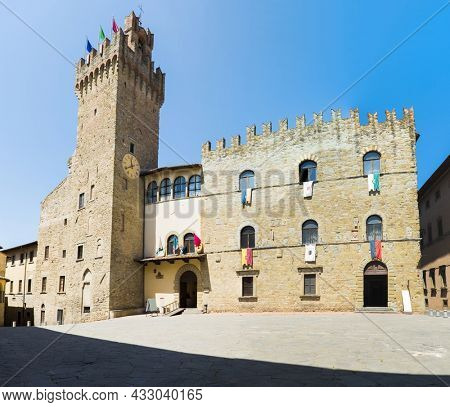 Panoramic photo of historic City Hall, Communal Palace in Arezzo city in Tuscany, Italy. The landmark is located on Piazza della Liberta square and was constructed in the 14th century