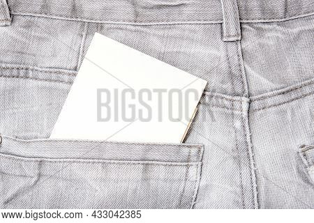 A White Blank Card In A Dark Gray Worn Jeans Pocket For Text, Copy Space