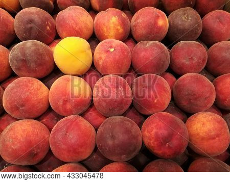 Red And One Yellow Nectarines, Arranged In A Grid, In A Greengrocer