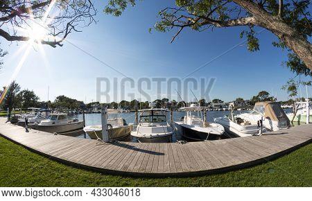 Babylon, New York, Usa - 7 September 2021: Fisheye View Of Boats Docked In A Marina On A Sunny Morni