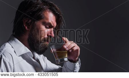 Bearded Man Drinks Whiskey, Brandy Or Cognac. Degustation And Tasting. Strong Alcohol. Sommelier Tas