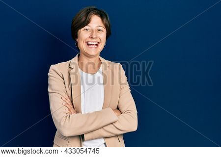 Young caucasian woman with arms crossed gesture smiling and laughing hard out loud because funny crazy joke.