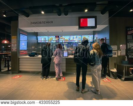 September 15, 2021 - Kharkiv, Ukraine: People Buy Food At A Fast Food Restaurant In The Evening. Peo