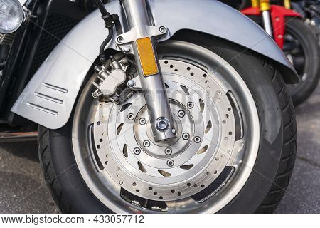 The Front Wheel Of A Motorcycle, A Side View Of The Front Wing Of A Motorcycle.