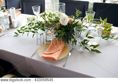 A Table Is Served In A Restaurant With A Beautiful Decor. The Cafe Hall Is Waiting For Guests For A